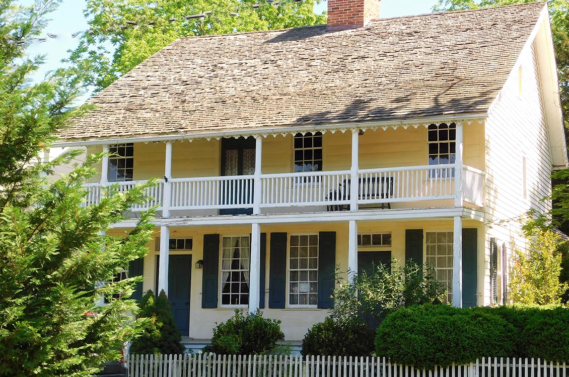 Indian Queen Tavern, c. 1740--National Register of Historic Places. Used as a tavern for many years, a massive center chimney supports four fireplaces on the first floor and two on the second.  British troops were garrisoned here during the French and Indian War.